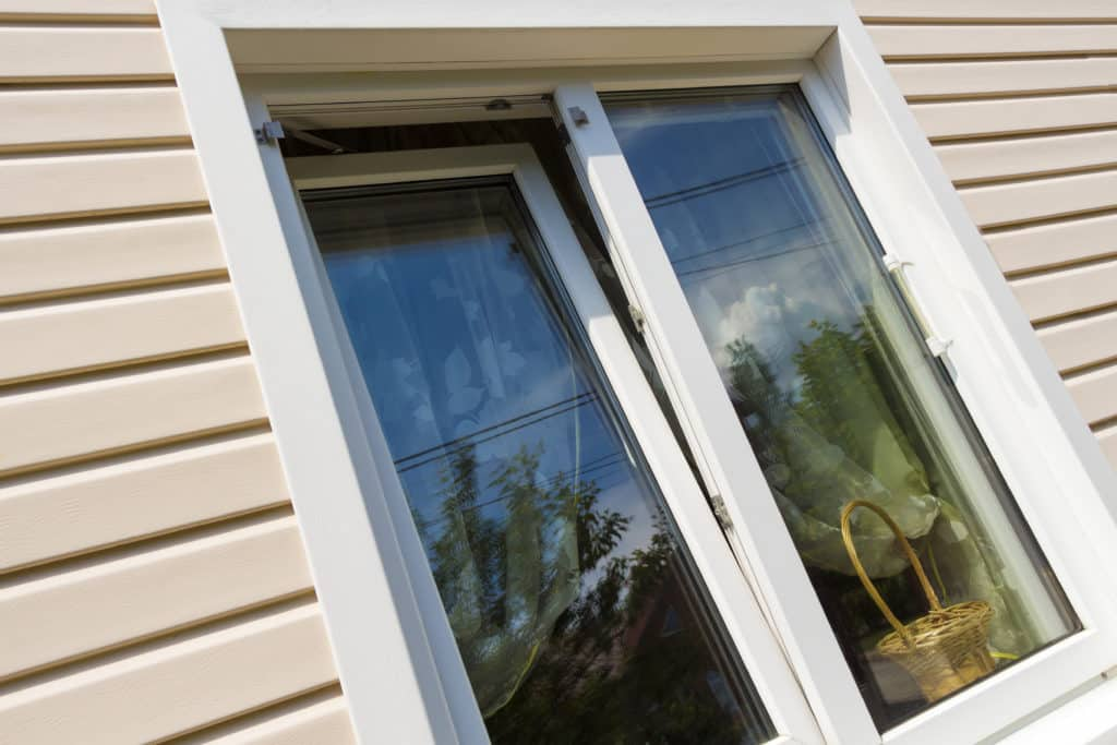 Beige plastic siding and windows