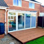 conservatory glass roof with Bifold Doors